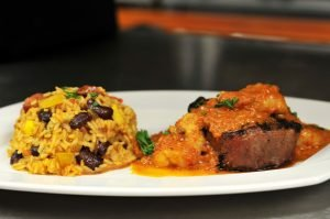8oz Filet Topped With Lobster In A Light Creole Sauce With Dirty Rice